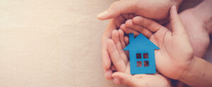 Hands holding a house to symbolize homeownership